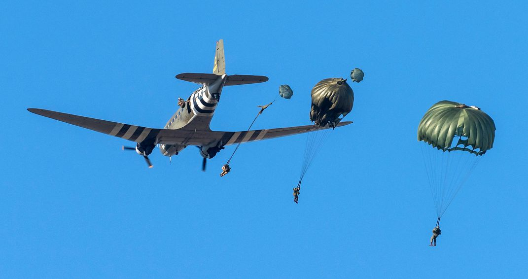 people parachute from a C-47