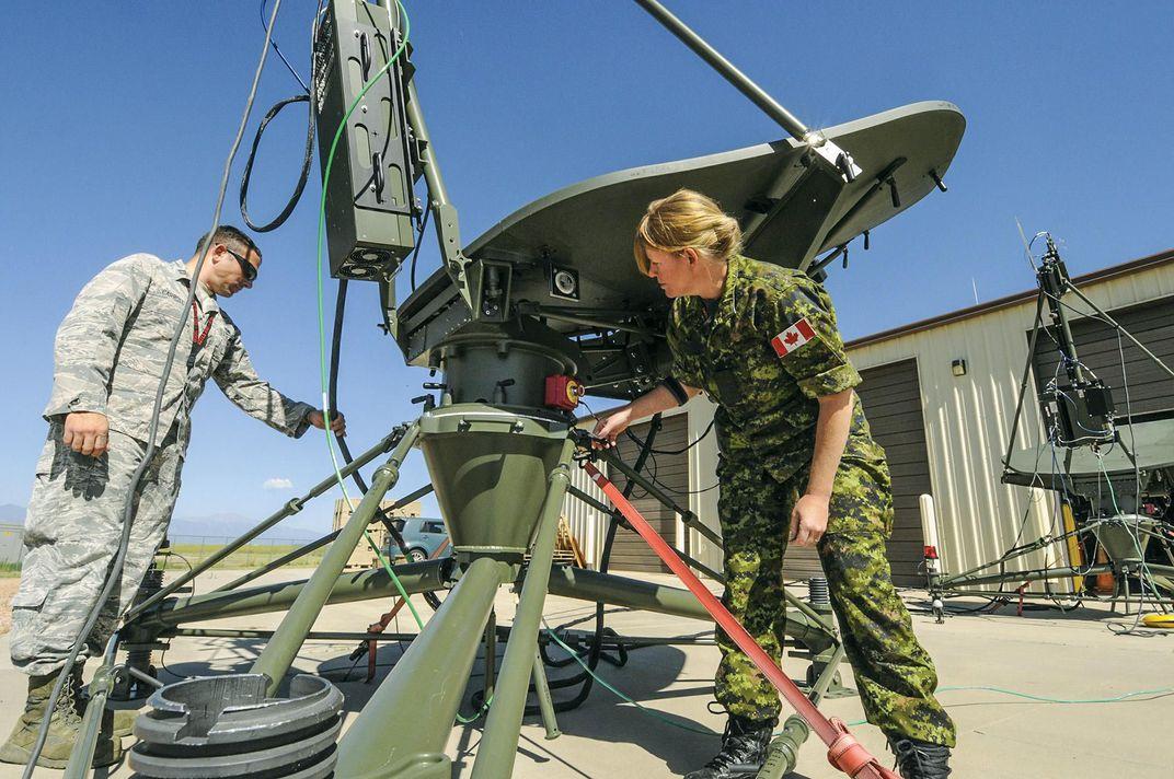 technicians set up antennas